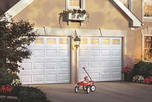 Garage door with red wagon on the driveway