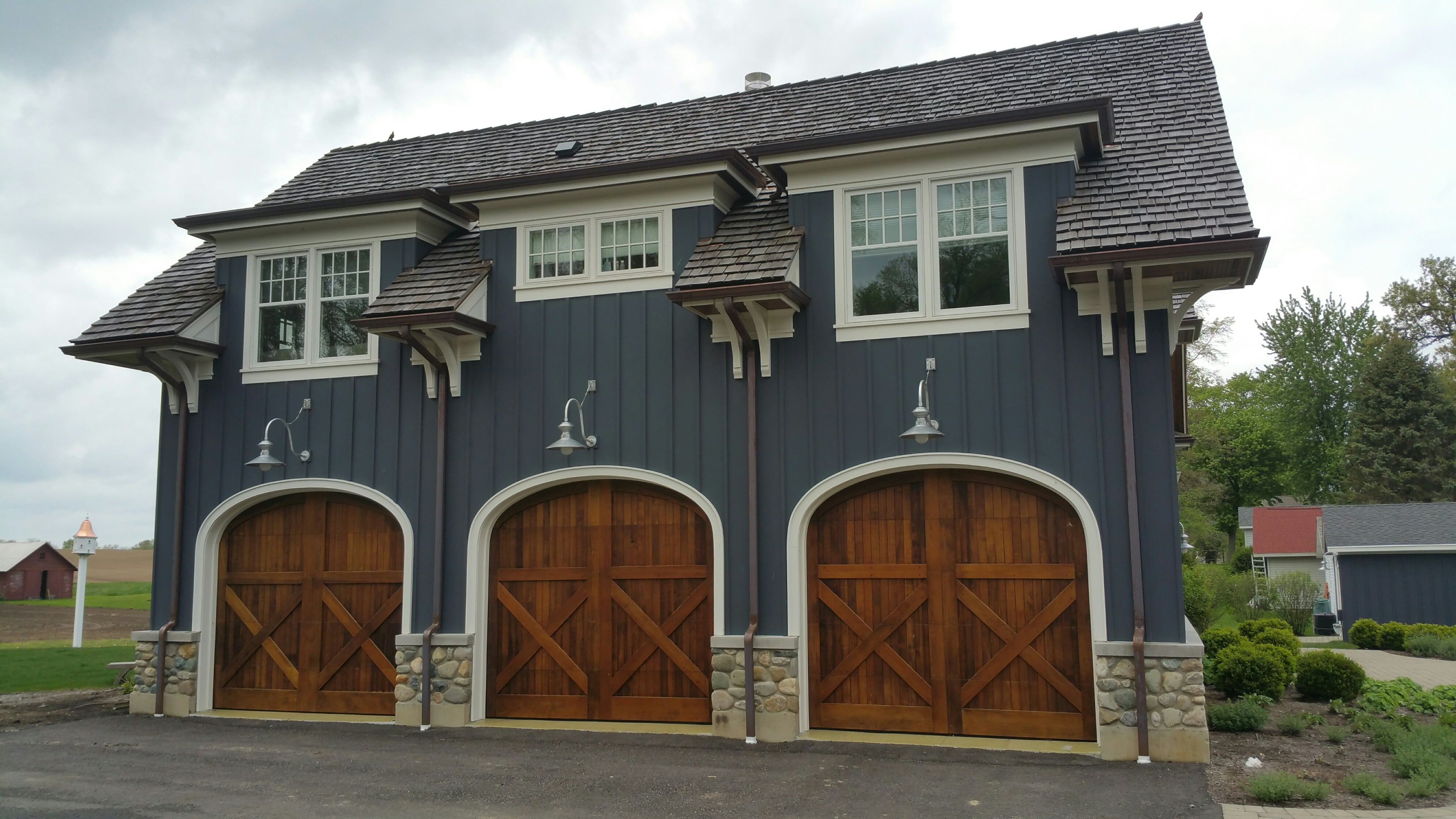 two photo residential garage in american neighborhood with suburban house car north storey stock door